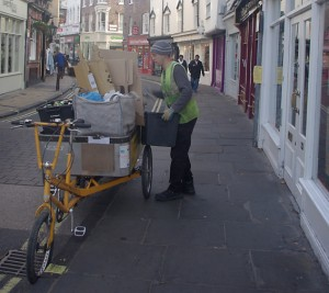 One of our recycling officers collecting materials from Goodramgate, using a load-bearing tricycle.