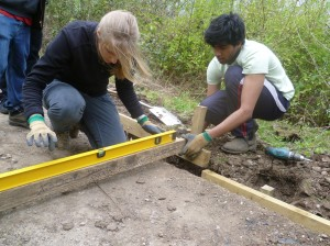 Volunteers building a path