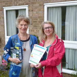 Winner of the event visitors survey prize draw Pat Hill with Alison Webb who provided an energy performance certificate for Pat's house