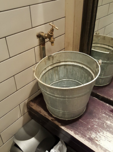 Bucket upcycled into a sink