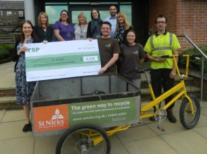 TSP Projects & St Nicks staff with £2,530 cheque