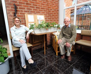Audrey & Duncan with strawberries in their conservatory