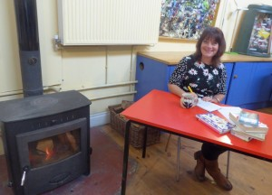 Ecotherapy Project Manager Kathy Sturgess preparing for a creative writing session by the fire