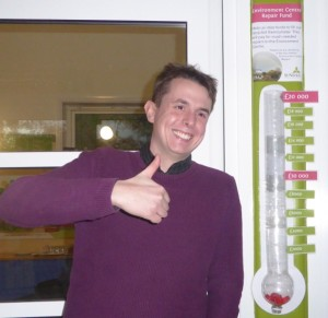 Neil with the fundraising thermometer