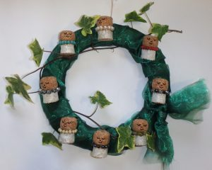 Anne's winning wreath: made of corks, beads from broken jewellery and scraps of material, plus ivy. The wreath can easily convert to make 8 decorations to hang on a Christmas tree.