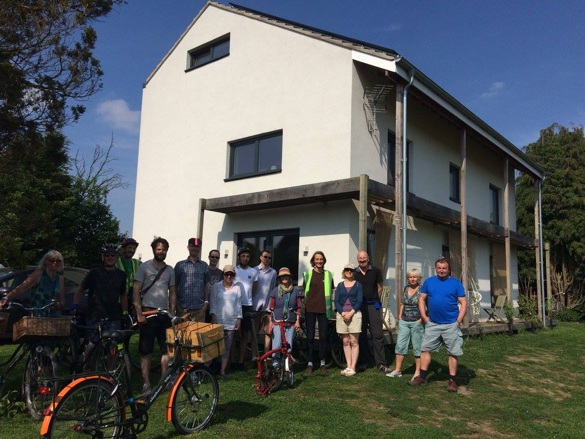 The author (in hi vis next to the house) organised a cycle tour of York Open Eco Homes in 2018, which visited the Fulford Passivhaus Plus – a home that generates more energy than its occupants use and keeps a more or less constant base temperature of 17°C.