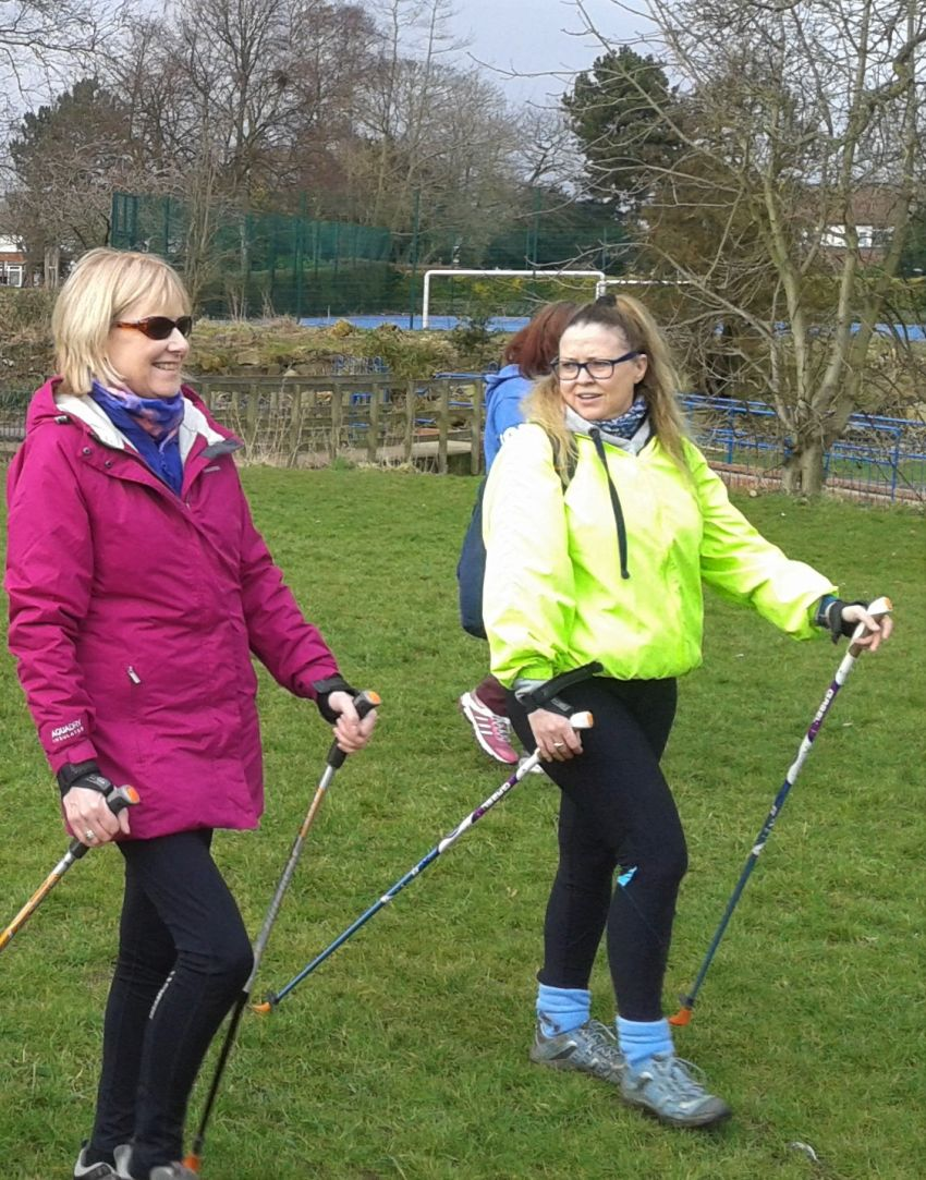 Nordic Walking instructor and participant walking