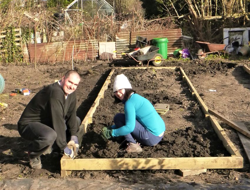 Ecotherapy participants making raised bed at allotment site