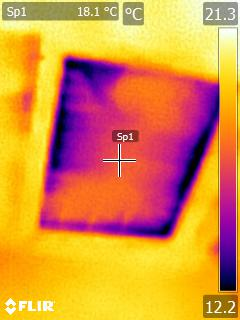 A thermal camera image of heat loss around a loft hatch