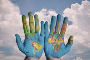 World map on hands, from Pixabay.com