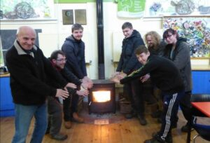 St Nicks volunteers by our stove in more sociable times